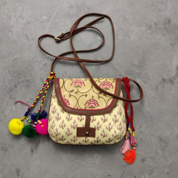 Beige and Pink Floral Hued Braided Sling Bag